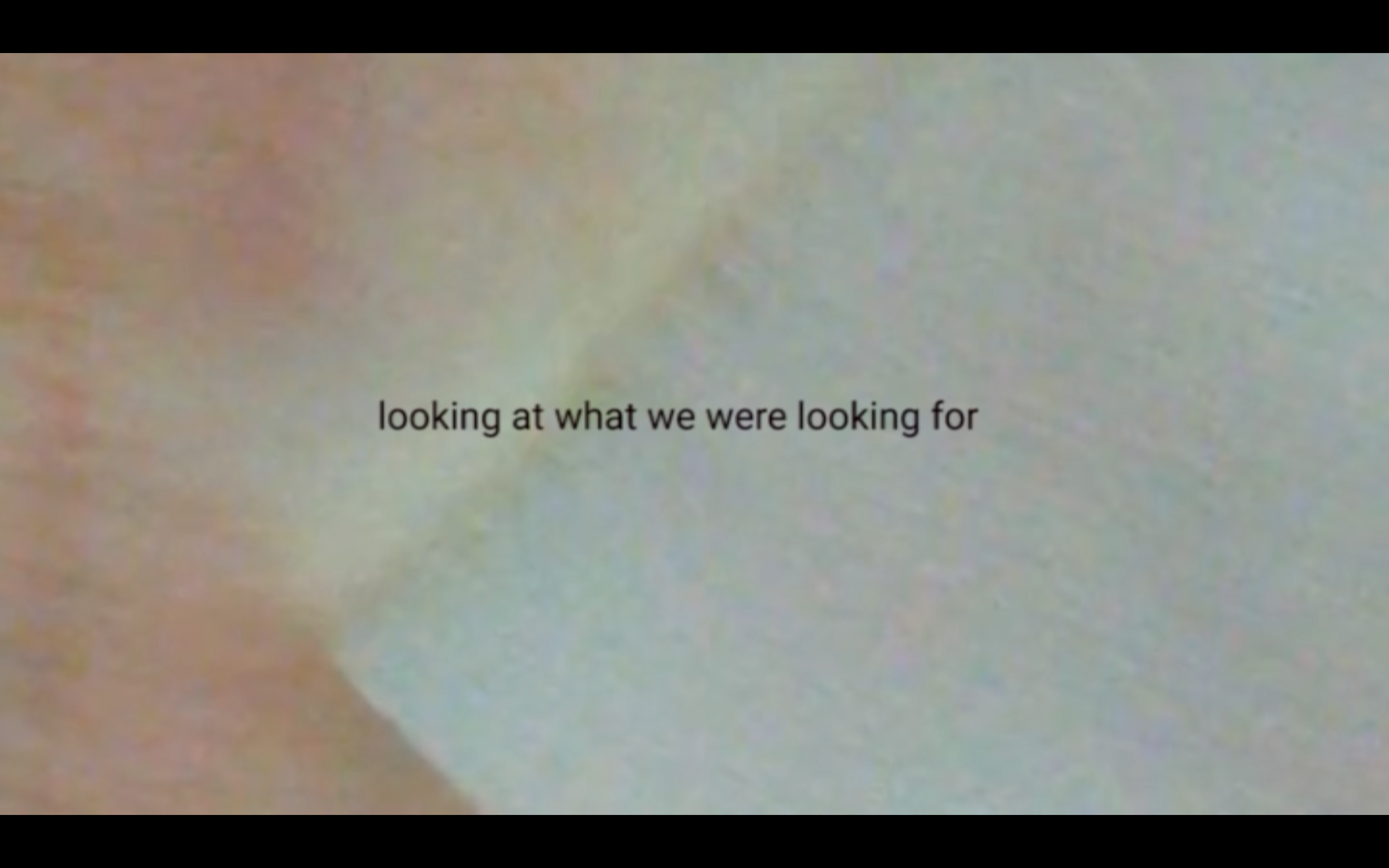 "tones of white skin and a white strip are the background of the image. Text in front reads: ""looking at what we were looking for"""