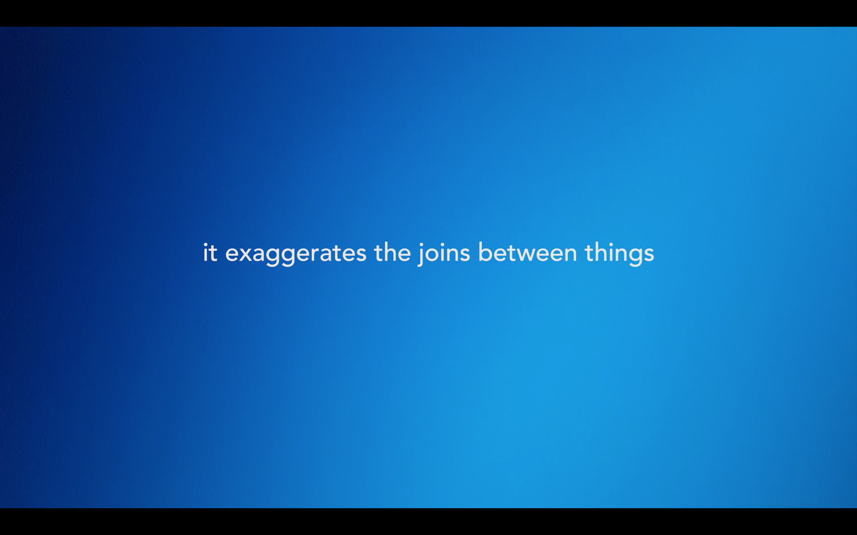 "video still. Background is bright blue with a gradient and white text says ""it exaggerates the joins between things"""